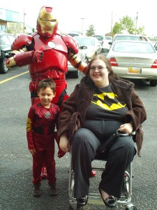 Kat Fury with Iron Man beside her and another Iron Man Behind her. The first iron man is very adorable and is around four years old.